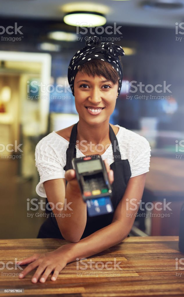 Smiling young African American female entrepreneur stock photo