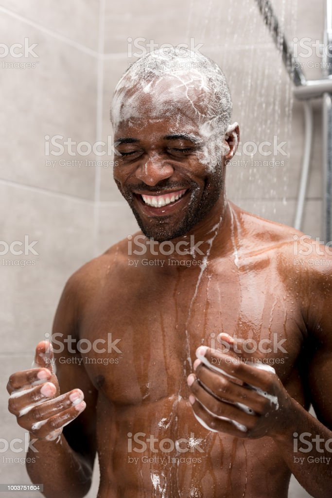 Smiling Young African American Man Washing Head With Shampoo In ...