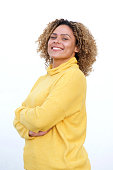 istock smiling young african american woman with arms crossed against isolated white background 1137796425