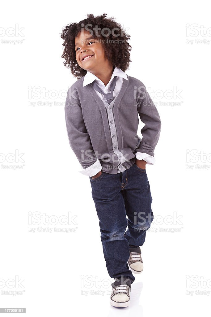Smiling young African boy standing on white background stock photo