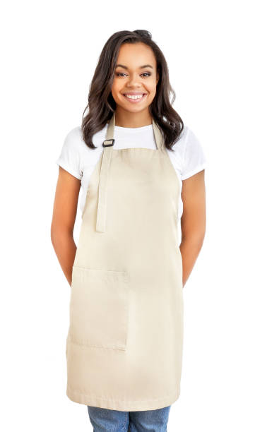 Smiling young african woman in apron Smiling young african woman in apron isolated on white background. Restaurant worker. Delivery service. apron stock pictures, royalty-free photos & images
