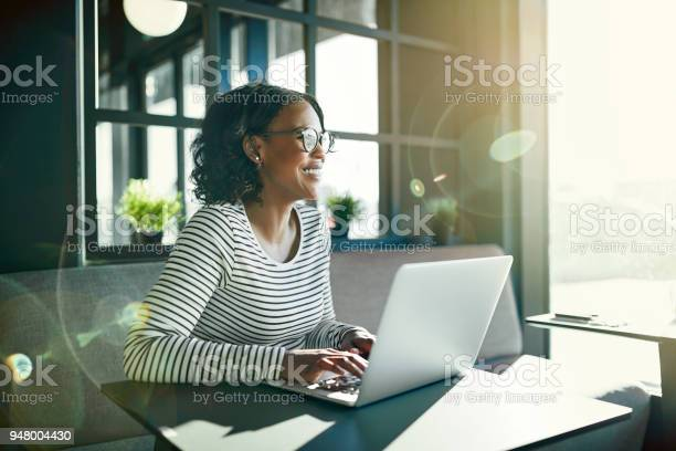 Smiling young african woman working online with her laptop picture id948004430?b=1&k=6&m=948004430&s=612x612&h=byf8av7thfhhuvxrrxa6hxnx6 dsp7mp8o7020vo8la=