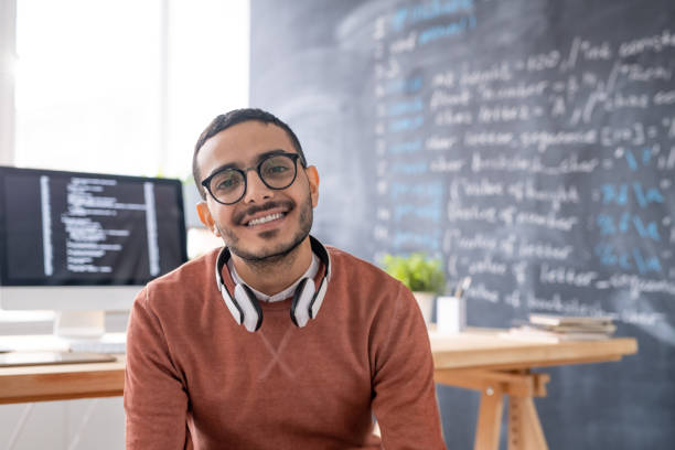 Smiling young Arabian programmer stock photo