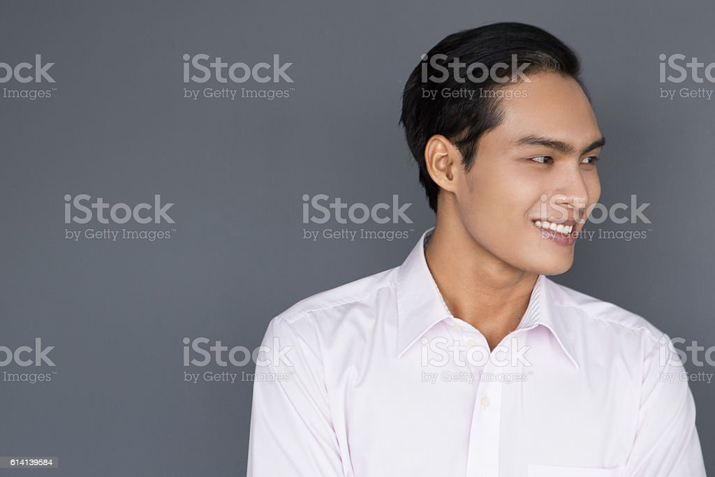Smiling Young Asian Businessman Looking Away stock photo