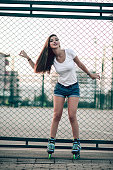 Smiling Young Athlete Female Posing on Court Fence