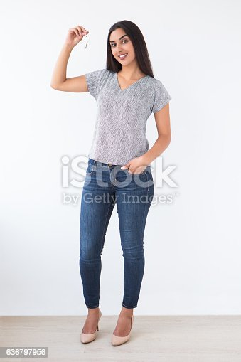 istock Smiling Young Attractive Indian Woman Raising Keys 636797956