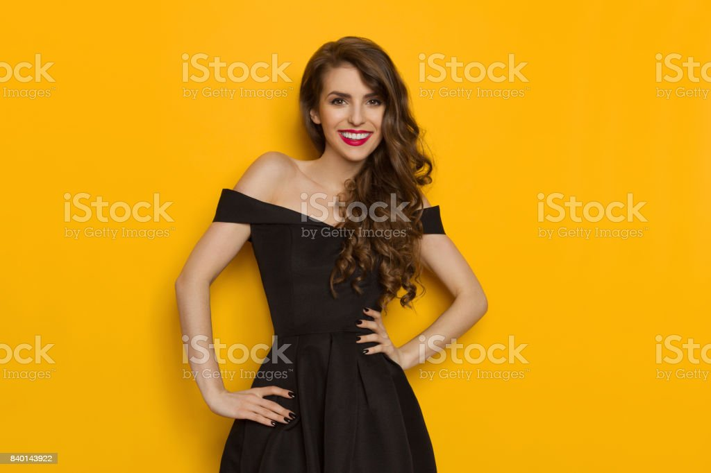 Smiling Young Beautiful Elegant Woman In Black Dress stock photo