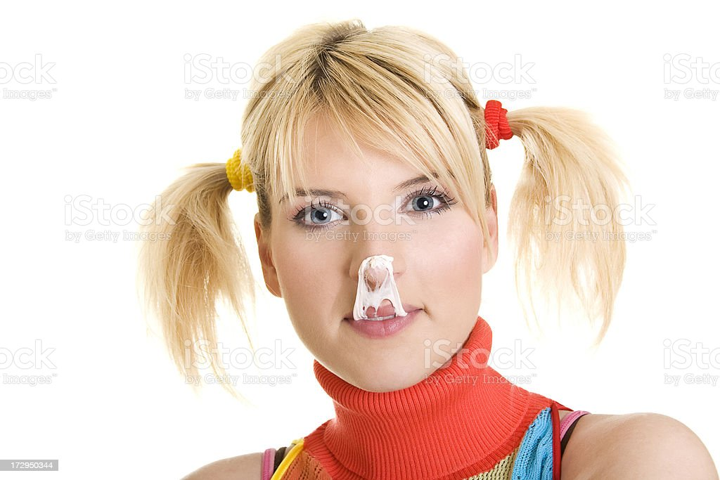 smiling young blond woman with pigtails stock photo