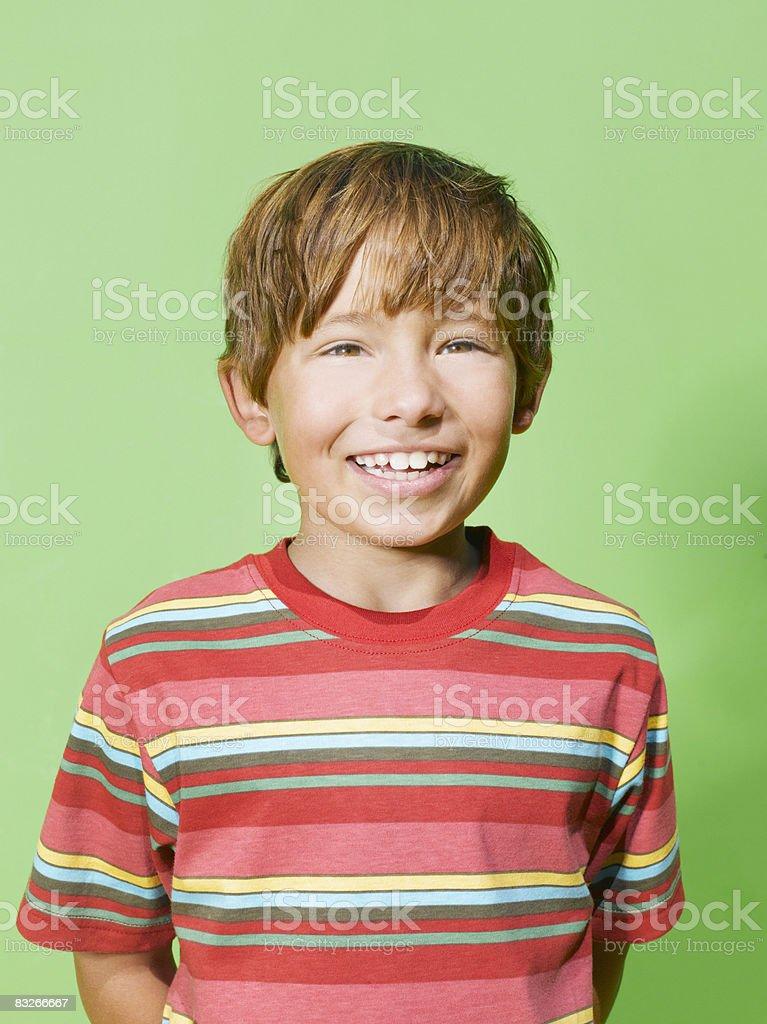 Smiling young boy royaltyfri bildbanksbilder