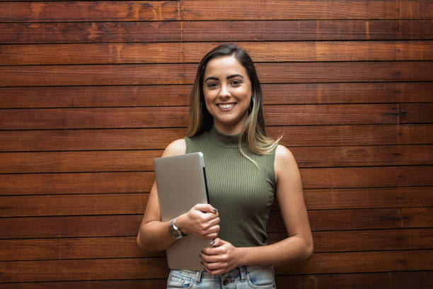 smiling young brazilian businesswoman with laptop stock photo