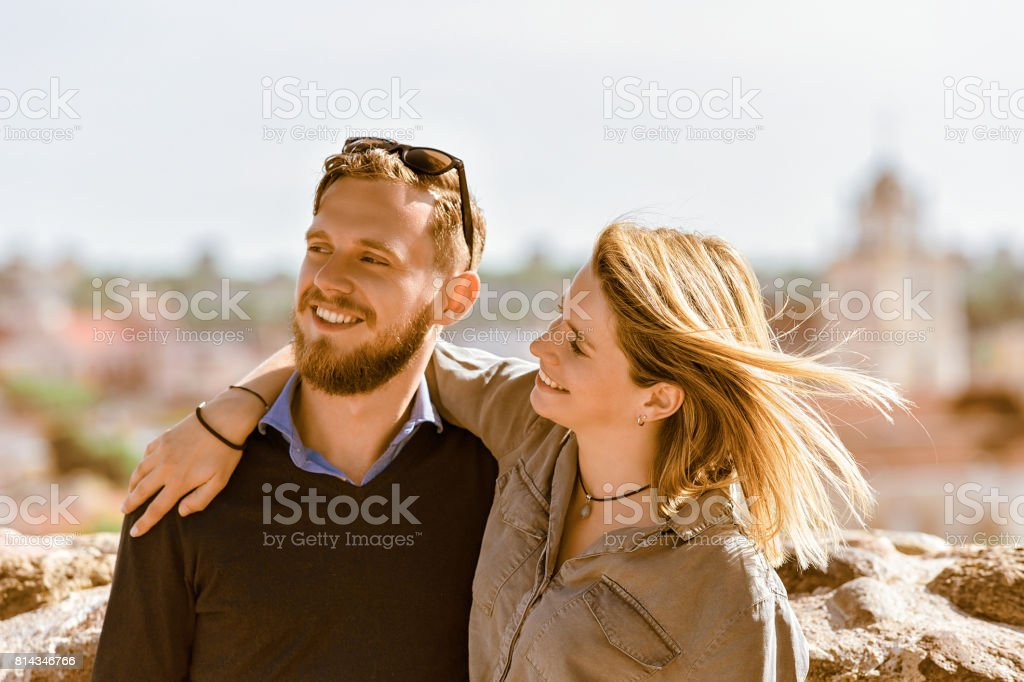 Smiling young brother and sister hugging stock photo