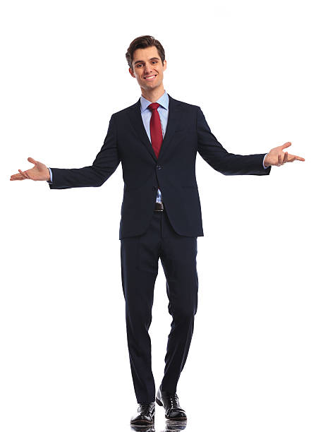 smiling young business man in suit and tie welcoming you stock photo