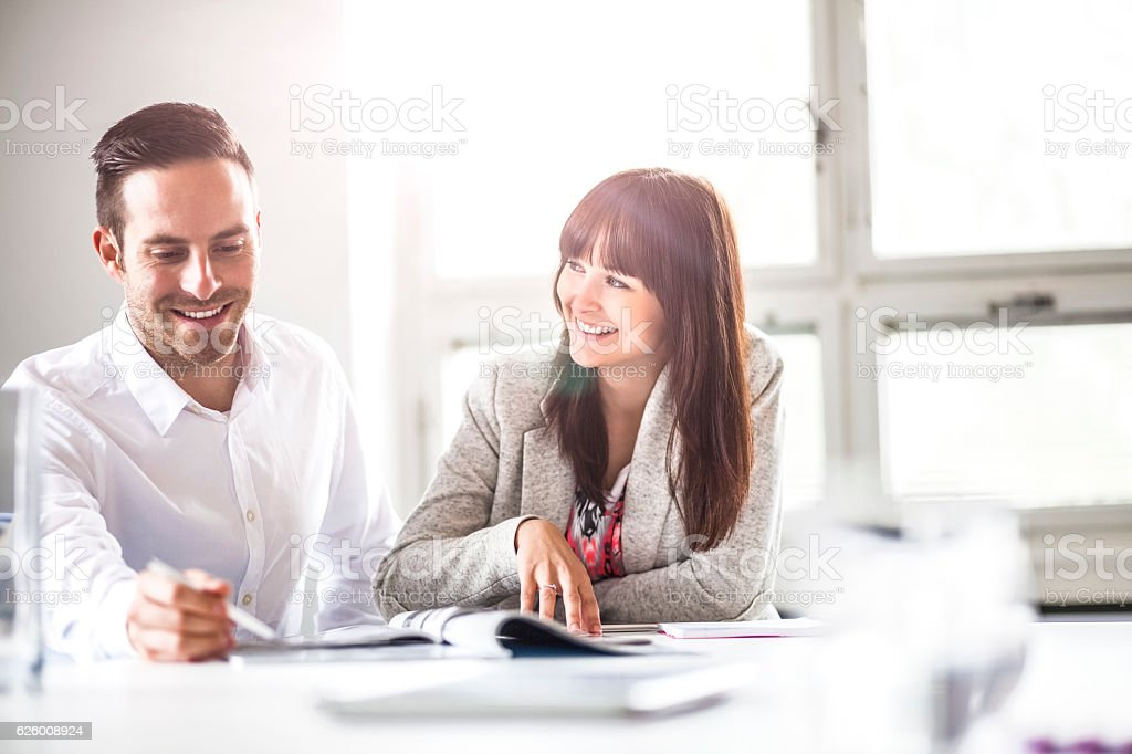 Smiling young business people discussing together in office – Foto