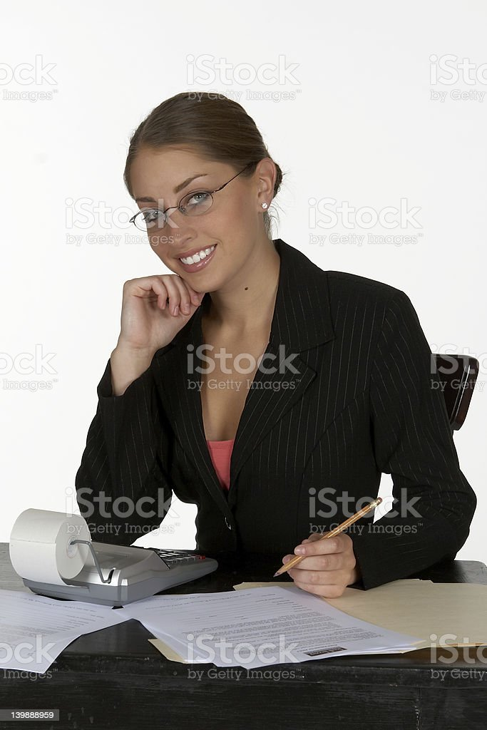 Smiling Young Business Woman at Desk royalty-free stock photo