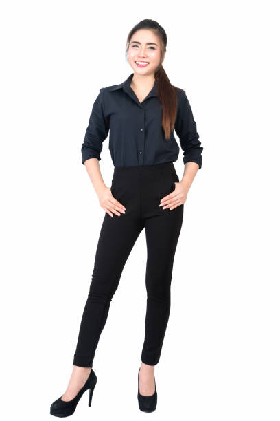 Smiling young business woman portrait in black long sleeve and slacks on white background stock photo
