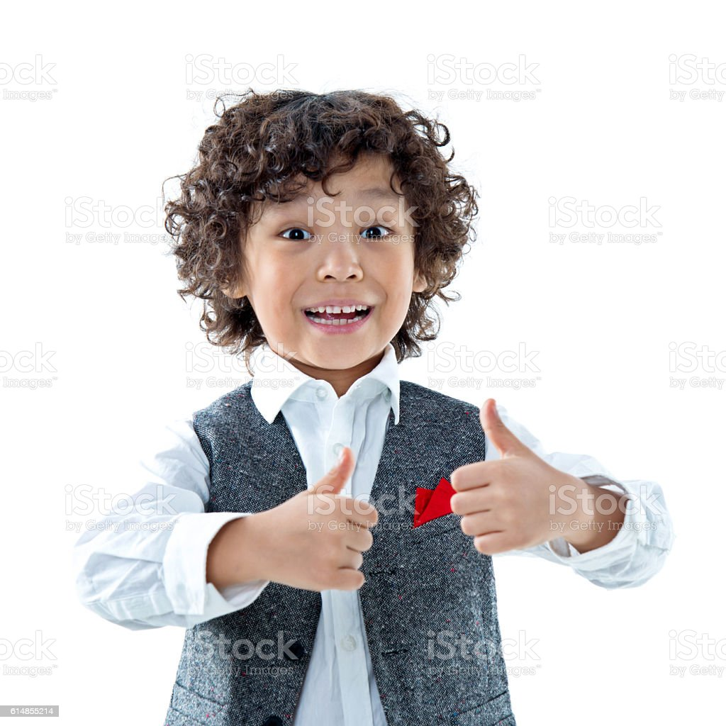 Smiling young businessman child boy with thumb up stock photo