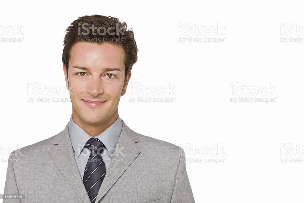 Smiling young businessman isolated on white background royalty-free stock photo