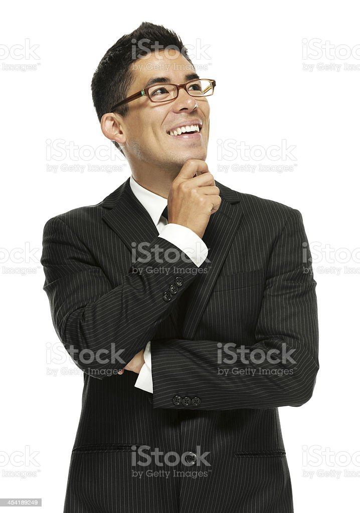 Smiling young businessman posing with hand on chin royalty-free stock photo