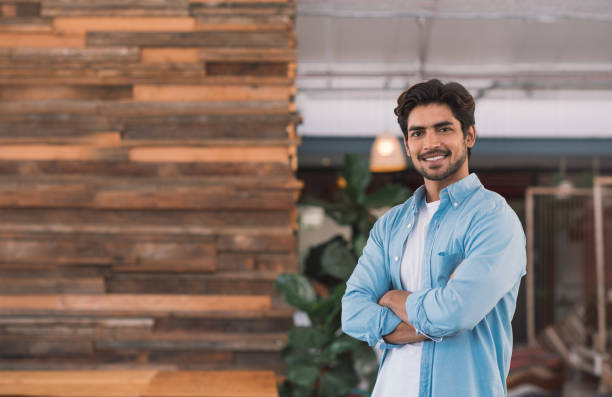 Smiling young businessman standing in an office stock photo