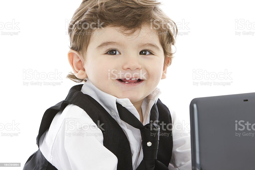 Smiling young businessman with computer royalty-free stock photo