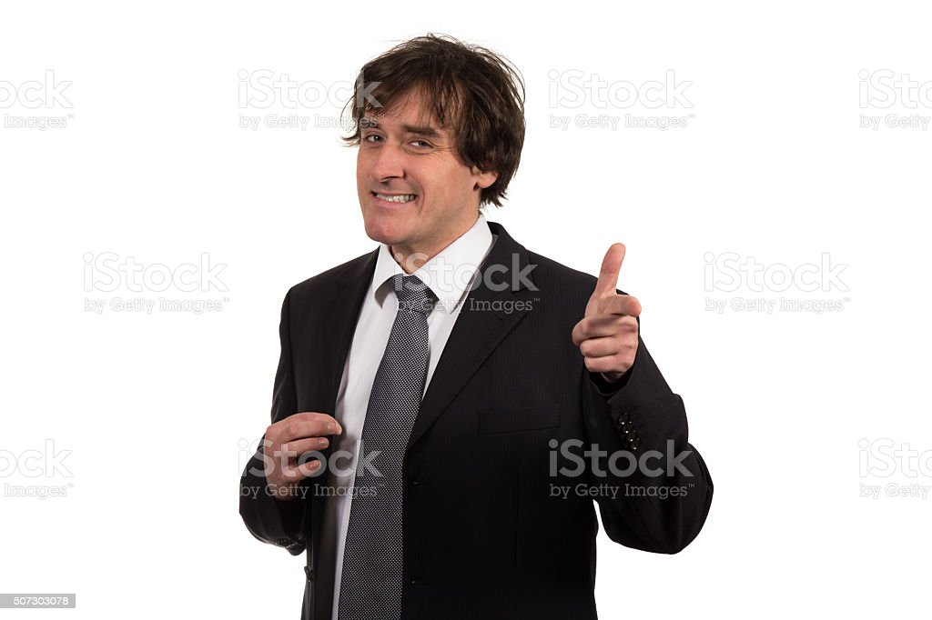 Smiling young businessman with his hand gestures imitating gun stock photo