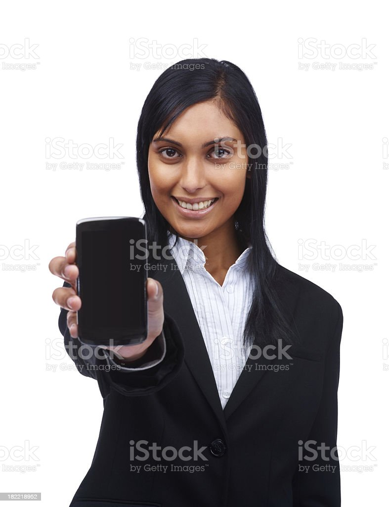Smiling young businesswoman holding a cellphone royalty-free stock photo