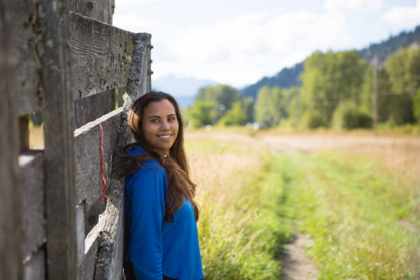 Smiling young Canadian First nation woman stock photo