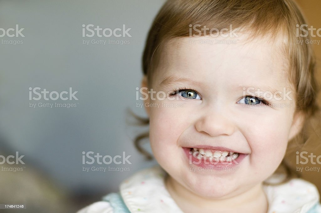 Smiling young child with blue eyes royalty-free stock photo