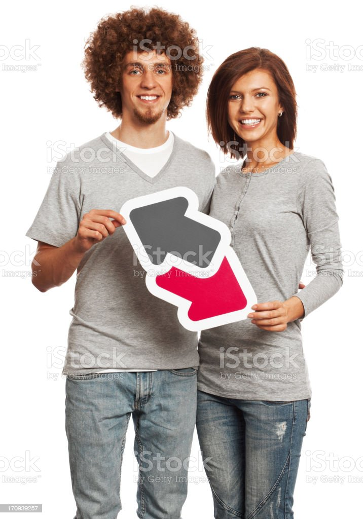 Smiling young couple holding data trade sign isolated on white royalty-free stock photo