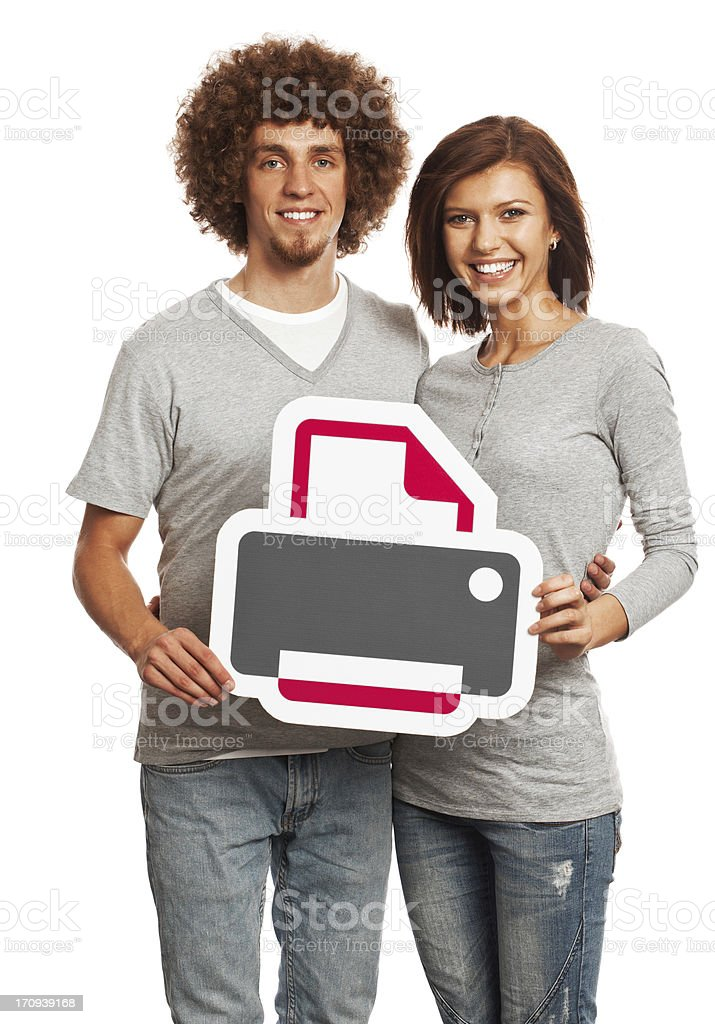 Smiling young couple holding printer sign isolated on white background. stock photo