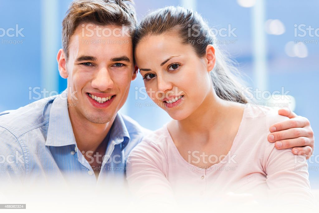 Smiling young couple looking at the camera. royalty-free stock photo