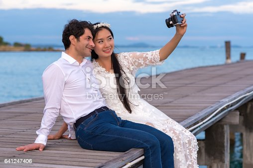 950598260 istock photo Smiling young couple making selfie 641247406