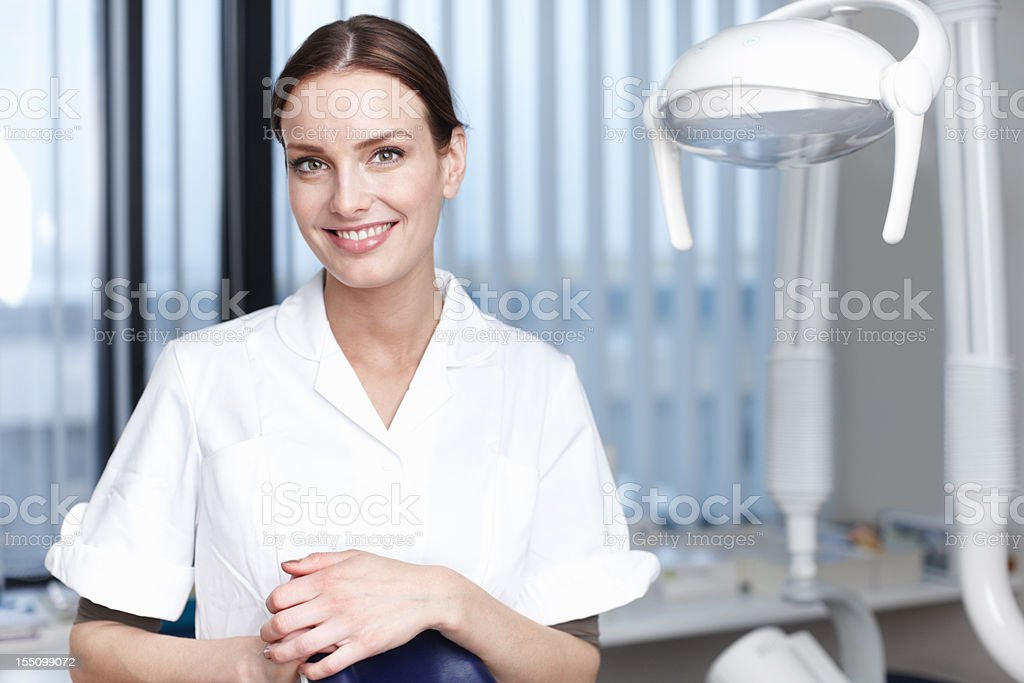 Smiling young dentist royalty-free stock photo