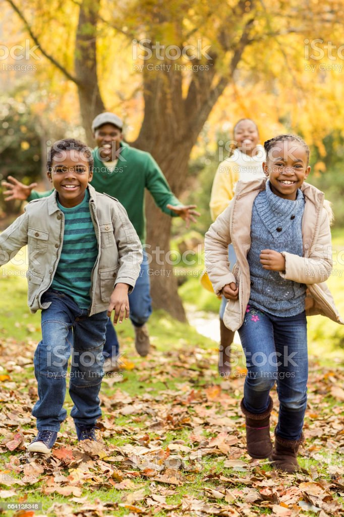 Smiling young family playing together foto stock royalty-free
