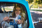 istock Smiling young female driver 1175727705