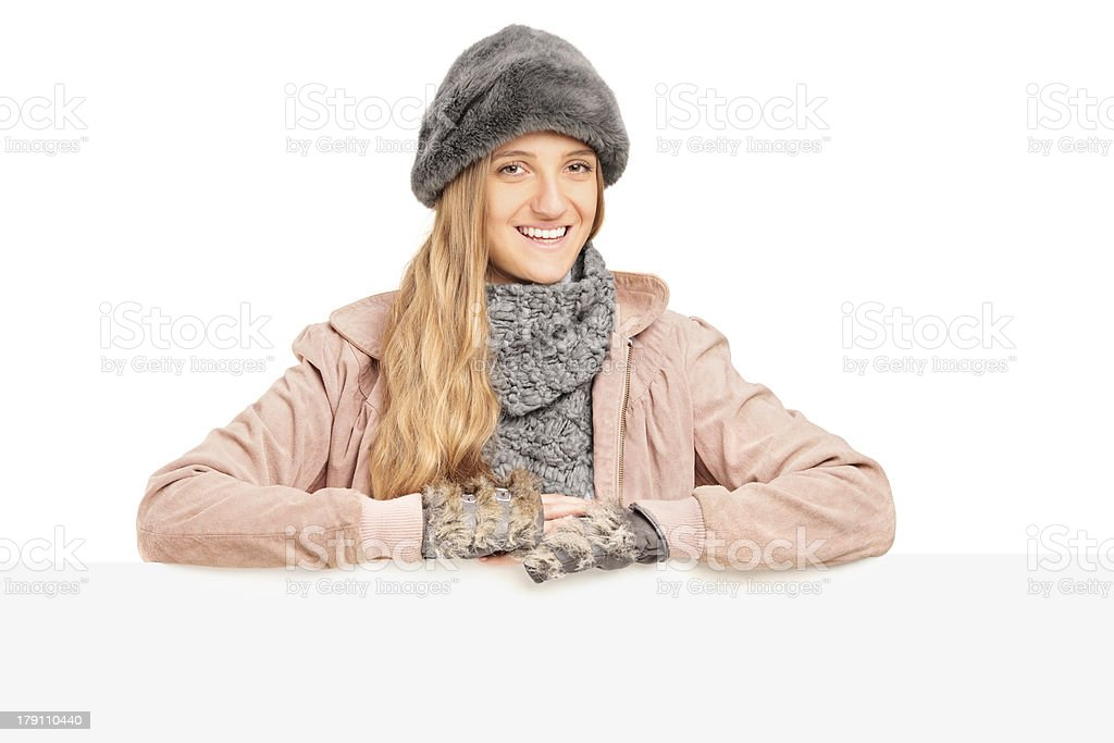 Smiling young female posing behind a panel royalty-free stock photo
