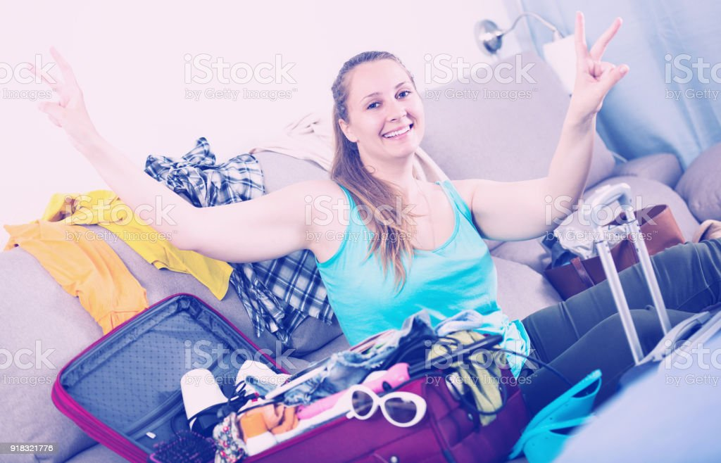Smiling young female ready to depart for holiday stock photo