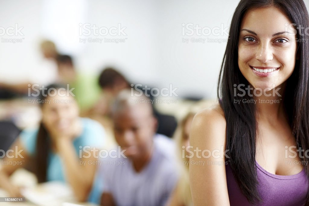 Smiling young female with friends in the background royalty-free stock photo