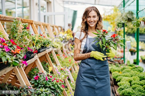 Attractive young woman in a flower center.