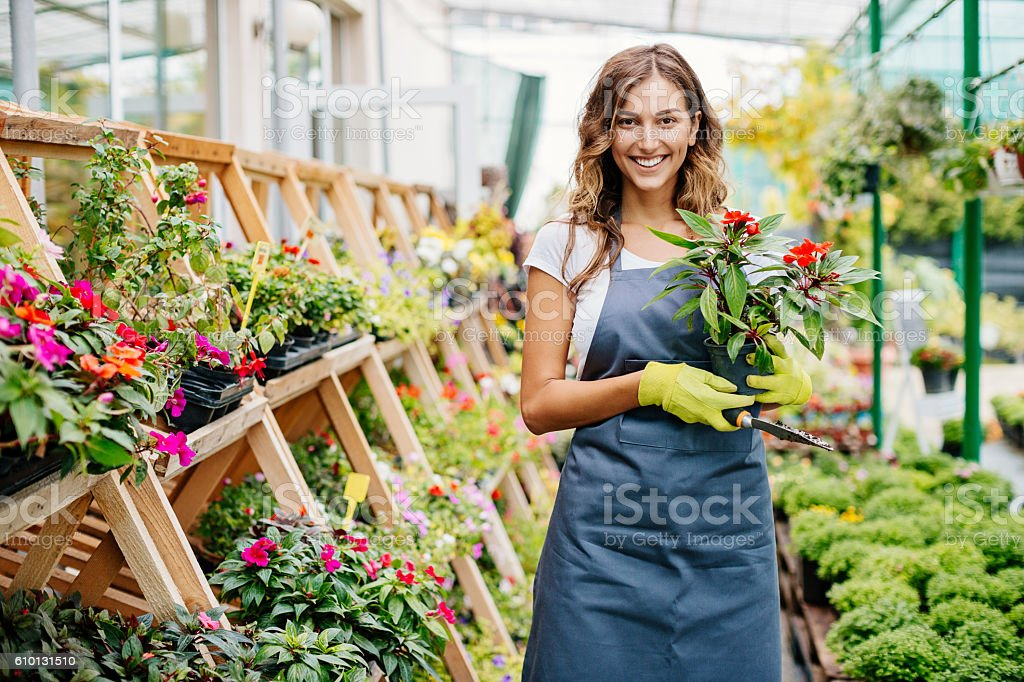 Smiling young gardener stock photo