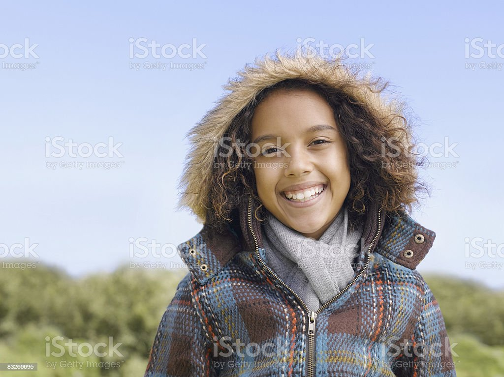 Smiling young girl in winter coat royalty-free stock photo