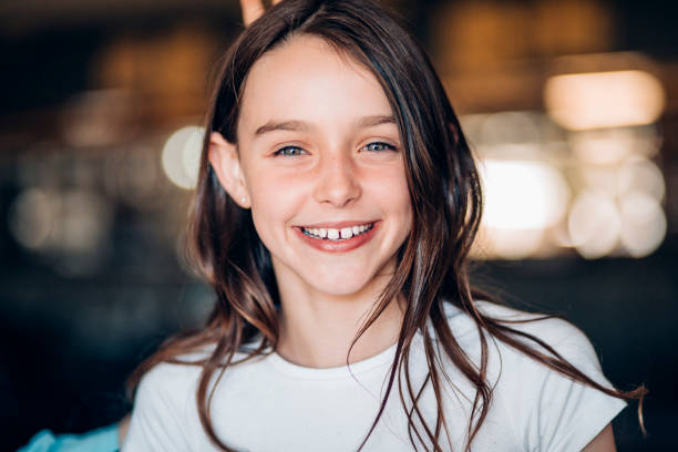 Smiling Young Girl Portrait of young girl smiling at the camera. pre adolescent child stock pictures, royalty-free photos & images