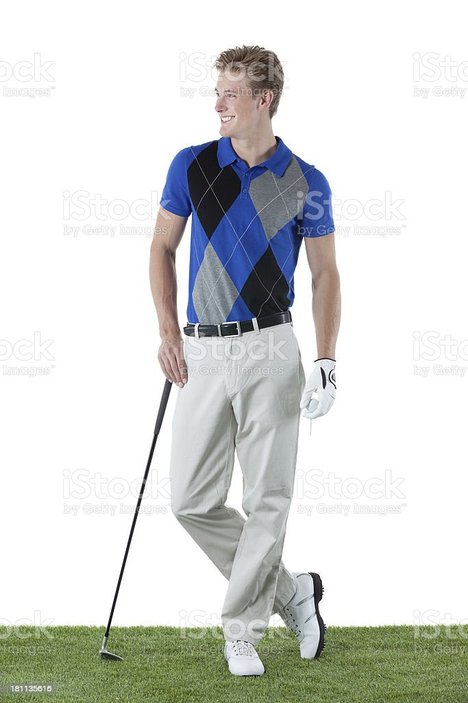 Smiling young golfer posing royalty-free stock photo