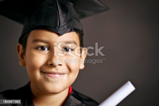 istock smiling young graduate 184997583