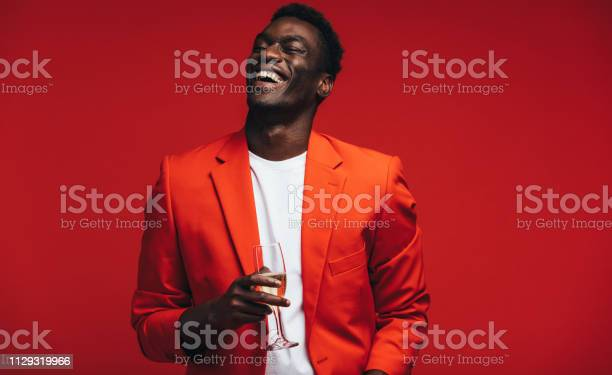 Smiling young guy having champagne picture id1129319966?b=1&k=6&m=1129319966&s=612x612&h=ayag g9iox7ly oddldhvy bfrjccjvpw9xzmkoeoxa=