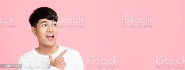 Smiling young handnsome asian man pointing hand to empty space aside picture id1155772197?b=1&k=6&m=1155772197&s=612x612&h=i5dn0bpajvzsb3xcfi6 f mkq qlpvp7iycr k0s nq=