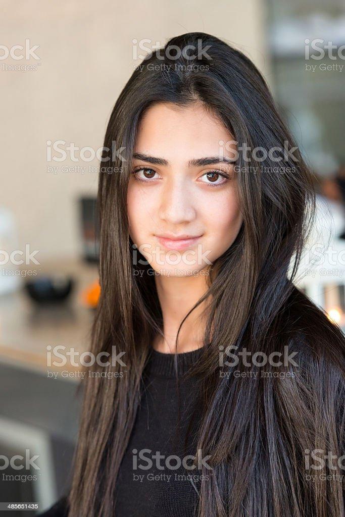 Smiling Young hispanic girl stock photo