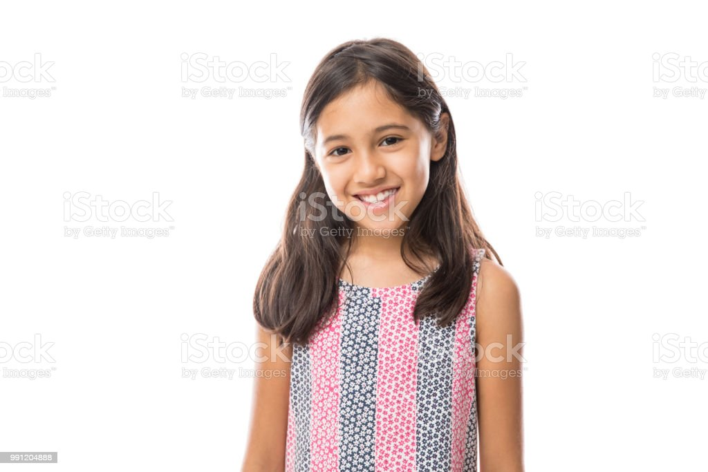 Smiling young hispanic girl posing and looking at the camera over white background royalty-free stock photo