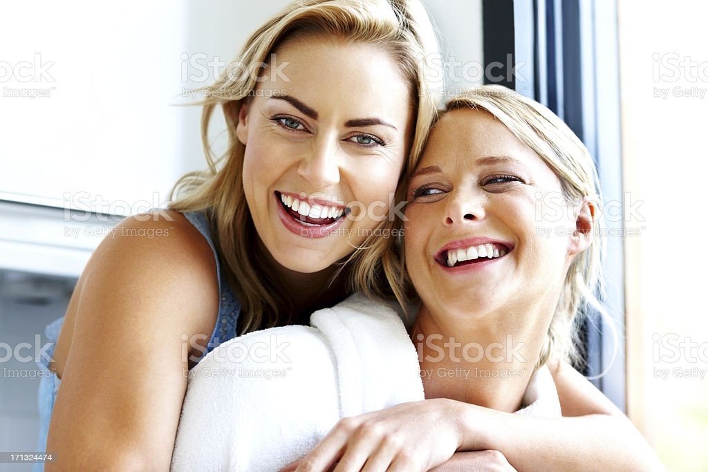 Smiling young homosexual couple together - Indoors stock photo