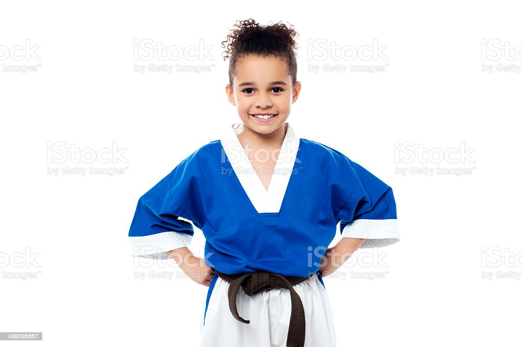Smiling young karate kid stock photo
